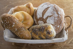 Breakfast. Some bread on a wooden table Stock Photography