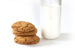 Breakfast of some cookies and bottle of milk. Some homemade cookies with a slices of chocolate and bottle fresh of milk Royalty Free Stock Images