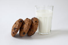 Breakfast of some cookies and glass of milk. Some homemade cookies with a slices of chocolate and bottle fresh of milk Royalty Free Stock Photography