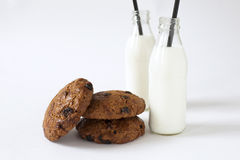 Breakfast of some cookies and two bottles of milk. Breakfast of some homemade cookies with raisins and two bottles of milk Stock Photography