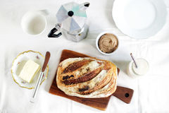 Breakfast of sourdough bread loaf and butter with coffee Stock Photo