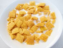 Breakfast square cornflakes with milk in a bowl Stock Photos