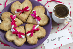 Breakfast on St. Valentine's Day. Tasty surprise in the message for lovers Stock Photography