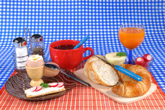 Breakfast, daily start. Breakfast, boiled egg, croissant and bread, butter, coffee and fruit juice  Food, nutrition, nourishment concept Royalty Free Stock Photo