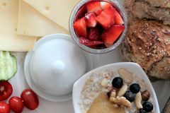 Breakfast with strawberries, bread and cheese, with textspace. Morning meal with healthy food Royalty Free Stock Image