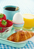 Breakfast with strawberries, juice, croissant and coffee Stock Photos
