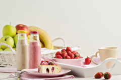 Breakfast. Strawberry cake and coffee, fruit and berries strawbe Royalty Free Stock Photos