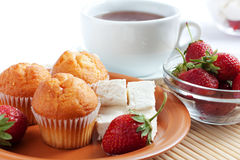Breakfast: strawberry, cream cheese, muffins, tea Royalty Free Stock Photo