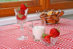 Breakfast with strawberry and milk. On table royalty free stock image