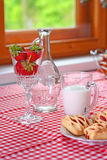 Breakfast with strawberry milk and bread. In the kitchen royalty free stock photos