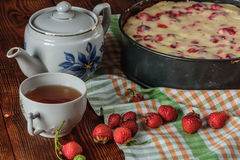 Breakfast with strawberry pie, black tea and berries Stock Image