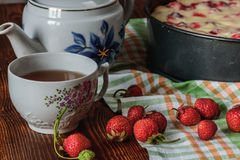 Breakfast with strawberry pie, black tea and berries Stock Images