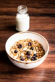 Breakfast super bowl of homemade granola or muesli with oat flakes, black currant, black raspberry and peanuts on a wooden table,. Selective focus. Served with stock images