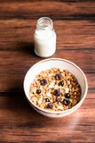 Breakfast super bowl of homemade granola or muesli with oat flakes, black currant, black raspberry and peanuts on a wooden table,. Selective focus. Served with stock photography