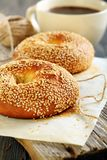 Breakfast. Sweet bagels with sesame seeds and coffee. Royalty Free Stock Image