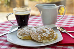 Breakfast in the table. Breakfast at the table with coffee and sweet pastries Royalty Free Stock Image