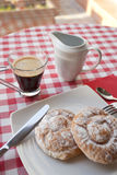 Breakfast in the table. Breakfast at the table with coffee and sweet pastries Royalty Free Stock Photos