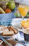 Breakfast in the table. Breakfast at the table with coffee and sweet pastries Stock Image
