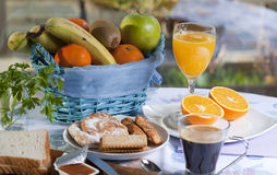 Breakfast in the table. Breakfast at the table with coffee and sweet pastries Royalty Free Stock Photo
