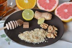 Breakfast table arrangement with jogurt, lemon, ground walnut and grapefruits. Breakfast table arrangement with jogurt,ground walnut and fruits royalty free stock images