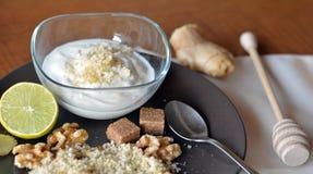 Breakfast table arrangement with jogurt, lemon, ground walnut. Breakfast table arrangement with jogurt,ground walnut and lemon stock photos