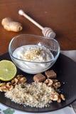 Breakfast table arrangement with jogurt, lemon, ground walnut. Breakfast table arrangement with jogurt with ground walnut stock image