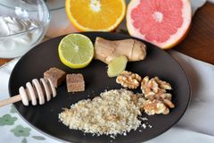 Breakfast table arrangement with jogurt, lemon, ground walnut and grapefruits. Breakfast table arrangement with jogurt,ground walnut and fruits royalty free stock photography