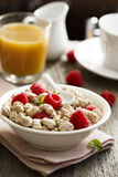 Breakfast. Table with bran, berries and juice Stock Photography