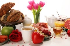 Breakfast on table with bread buns, croissants, coffe and juice on valentines day stock images