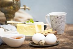 Breakfast table with bread slice, butter, black caviar, milk and honey. On wooden table Royalty Free Stock Photography