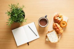 Breakfast table with breads and hot chocolate Royalty Free Stock Photos