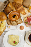 Breakfast table with Cheese bread, coffee, egg, ham and jam Stock Photo