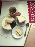 Breakfast on the table: coffee, cheesecake and white chocolate Stock Image