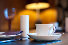 Breakfast. Table with coffee and plate Royalty Free Stock Photography