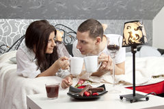 Breakfast on a table with couple lying Stock Photo