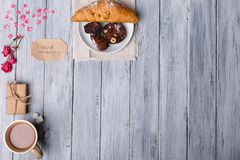 Breakfast, on the table, a croissant with a chocolate cake, on a gray background, a free place for text. Stock Images