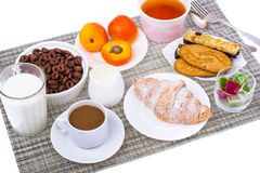 Breakfast table with croissant, muesli, milk, honey and fruits. Studio Photo Stock Images