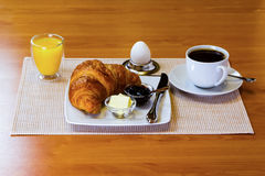 Breakfast table. Breakfast with croissant , orange juice and egg Stock Photos