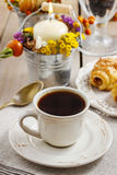 Breakfast table: cup of coffee and buns with chocolate Stock Photo