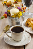 Breakfast table: cup of coffee and buns with chocolate Stock Image