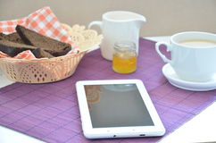 Breakfast on the table cup with tea milkwoman rye bread curds orange jam on a purple napkin white tab Stock Photography