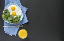 Breakfast. top view. black background. eggs stock photos