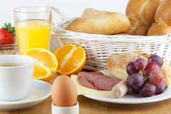 Breakfast table. With a fresh egg and sausage Royalty Free Stock Image