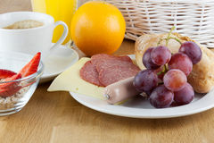 Breakfast table. With a fresh egg and sausage Stock Image