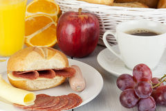 Breakfast table. With a fresh egg and sausage Stock Images