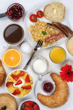 Breakfast table with fruits, coffee and orange juice from above. Breakfast table with a cereals, bagels, marmalade, coffee and orange juice from above Stock Photography