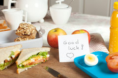 Breakfast table with good luck note Royalty Free Stock Photo