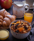 Breakfast table with granola, croissants, apple, coffee, juice Royalty Free Stock Photography