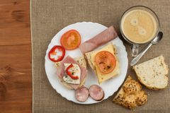 Breakfast on the table. Ham, tomato and cheese for breakfast with bread. Homemade healthy food. Vegetables and ham for breakfast. Stock Image