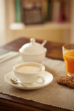 Breakfast table with juice, coffe and cookies Royalty Free Stock Photos